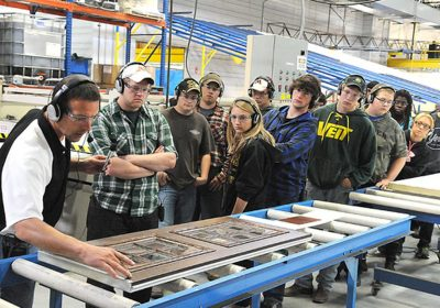 students on a manufacturing facility tour