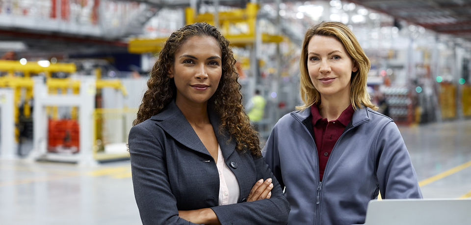 Female professionals in car plant